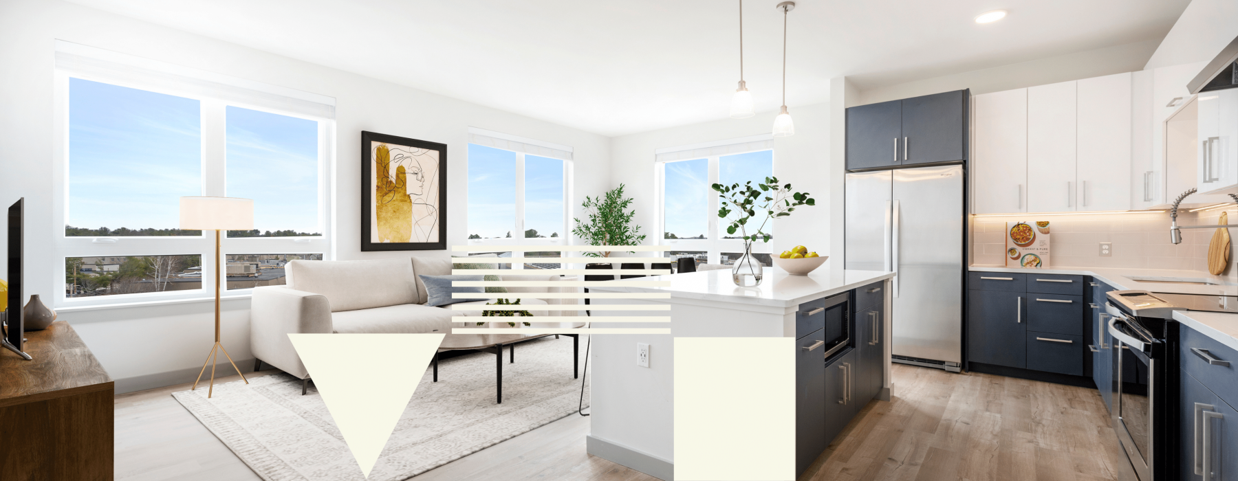 Staged open concept living room and kitchen with built-in island